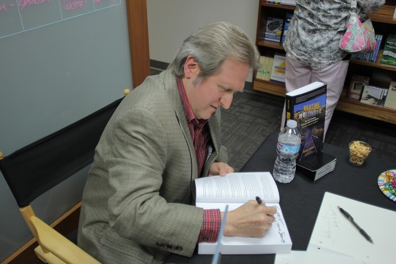 Steve Cuden signing a book